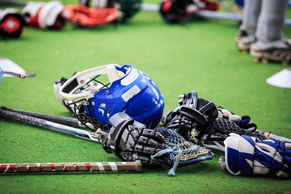 Helmets and Lacrosse Sticks